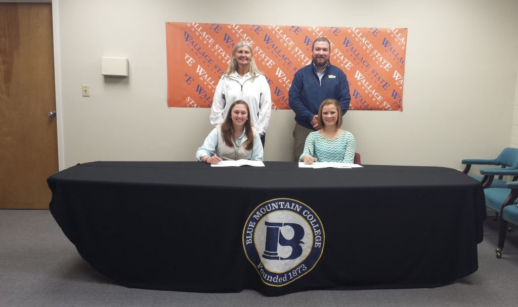 Wallace State softball sophomores Brooke Kinsey, left, and Kaitlyn Whitehead have signed to play for the Blue Mountain College Lady Toppers, beginning with the 2016 season. Also pictured are, from left, Wallace State softball coach Jayne Clem and Blue Mountain coach Kevin Barefield.
