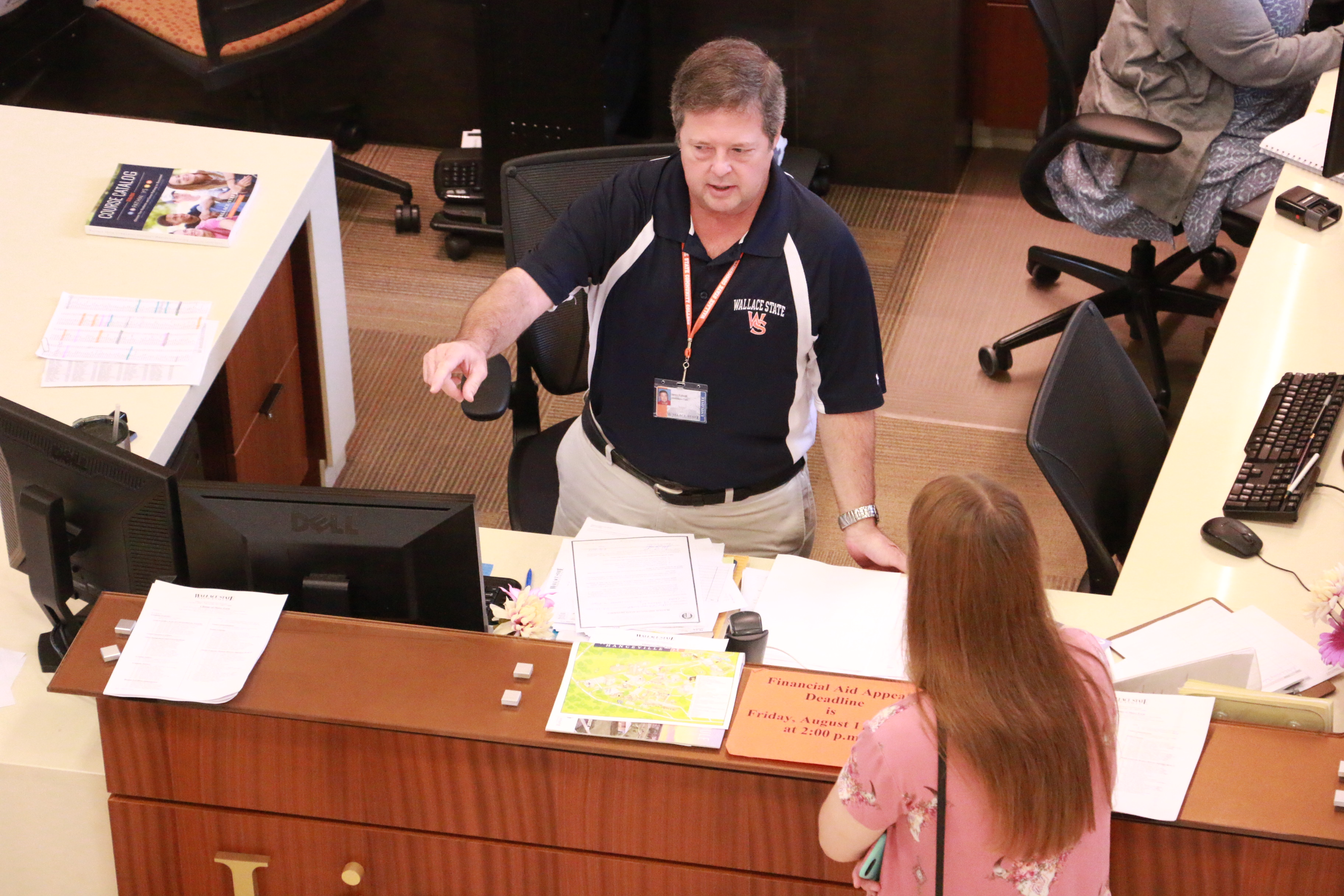 wallace-states-james-tidwell-assists-a-student-at-lion-central.jpg